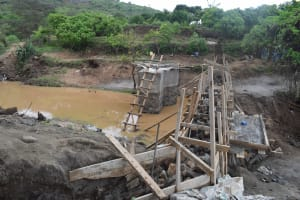 The Water Project: Mbiuni Community -  View Of Well And Dam During Construction