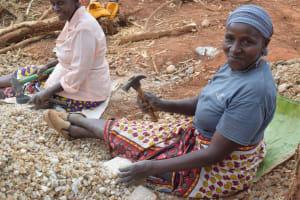 The Water Project: Mukuku Community A -  Breaking Up Small Rocks
