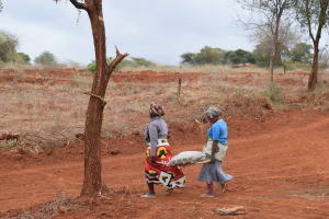 The Water Project: Mukuku Community A -  Carrying Cement Bag