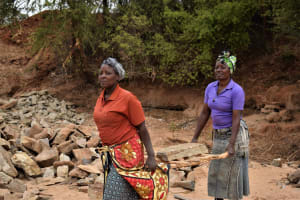 The Water Project: Mukuku Community A -  Hauling Rocks