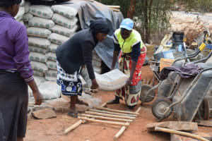 The Water Project: Mukuku Community A -  Lifting Cement Bag