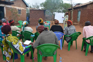 The Water Project: Kathuli Community A -  Attendees Listen During The Training