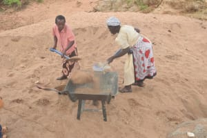 The Water Project: Kathuli Community A -  Filling Wheelbarrow With Sand