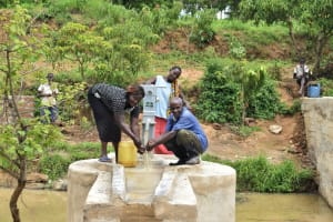 The Water Project: Mbiuni Community A -  Collecting Water At The New Well