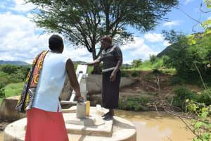 The Water Project: Mbiuni Community A -  Pumping At The Well