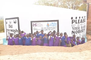 The Water Project: Kwa Kyelu Primary School -  Students At The Tank