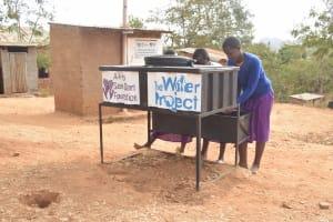 The Water Project: Kwa Kyelu Primary School -  Using The Handwashing Station