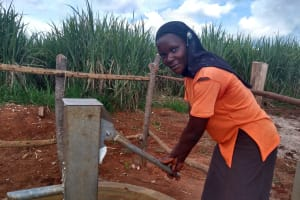 The Water Project: Nyakasenyi Byebega Community -  Pumping The Well