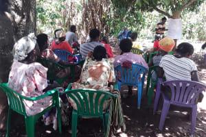 The Water Project: Nyakasenyi Byebega Community -  Shg Members Listen During The Training
