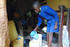 The Water Project: Boyani Primary School -  Student Collecting Water From Home