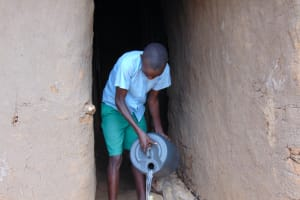 The Water Project: St. Kizito Kimarani Primary School -  Student Fetching Water From Home Before School
