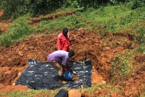 The Water Project: Shisere Community, Richard Okanga Spring -  Laying The Foundation