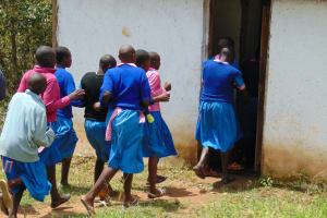 The Water Project: Gidimo Primary School -  Girls Rushing To Use Latrines