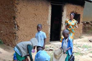 The Water Project: St. Kizito Kimarani Primary School -  Students Help School Cook Prepare Lunch Outside The Kitchen