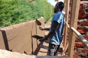 The Water Project: Gimariani Secondary School -  Cementing Latrine Entryway Walls