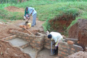 The Water Project: Ebutindi Community, Tondolo Spring -  Pipe Setting During Early Cement Work