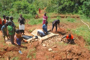 The Water Project: Shisere Community, Richard Okanga Spring -  Community Helping In Backfilling
