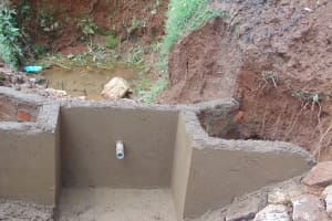 The Water Project: Ebutindi Community, Tondolo Spring -  Spring Wall Plaster Works