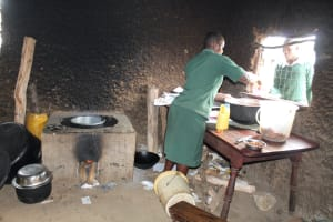 The Water Project: Sawawa Secondary School -  School Cook Serves Lunch