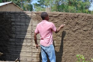 The Water Project: Gimariani Secondary School -  Adding Outer Rain Tank Wall Cement