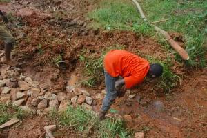 The Water Project: Shisere Community, Richard Okanga Spring -  Hardcore Backfilling