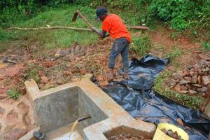The Water Project: Shisere Community, Richard Okanga Spring -  Soil And Palstic Tarp Backfilling