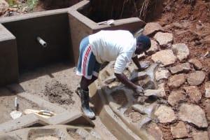 The Water Project: Ebutindi Community, Tondolo Spring -  Working On The Rub Wall