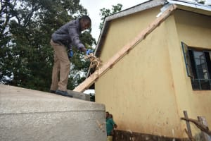 The Water Project: Friends School Mutaho Primary -  Field Officer Clearing The Gutters Of Leaves