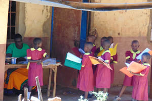The Water Project: Givudemesi Primary School -  Students Handing In Assignments