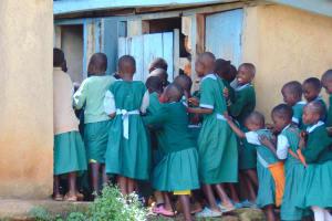 The Water Project: St. Kizito Kimarani Primary School -  Girls Scramble At Their Latrines