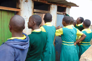 The Water Project: Gamalenga Primary School -  Girls Lined Up At Their Latrines