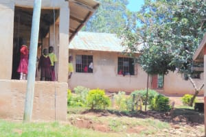 The Water Project: Givudemesi Primary School -  Students Peer Out From Their Classroom