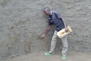 The Water Project: Gimariani Secondary School -  Cementing Interior Of Rain Tank Walls