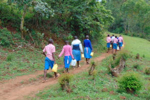 The Water Project: Gidimo Primary School -  Kenya Carrying Water