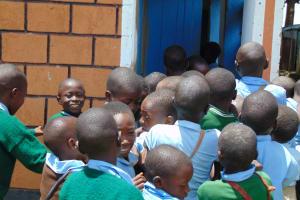 The Water Project: St. Kizito Kimarani Primary School -  Boys Scramble At Their Latrines