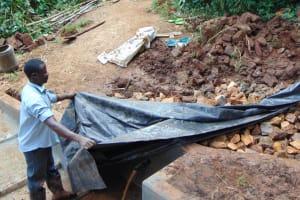 The Water Project: Ebutindi Community, Tondolo Spring -  Fitting The Plastic Tarp