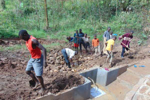 The Water Project: Bumavi Community, Joseph Njajula Spring -  Community Helps Out In Backfilling