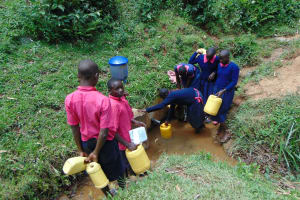 The Water Project: Jinjini Friends Primary School -  Students Collecting Water