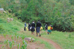 The Water Project: Kinu Friends Secondary School -  Students Going To Fetch Water