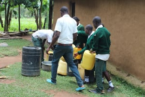 The Water Project: Sawawa Secondary School -  Students Fetching Water From Home