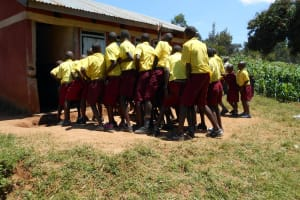 The Water Project: Givudemesi Primary School -  Boys Pushing In Line To Use Latrines