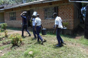 The Water Project: Friends School Shivanga Secondary -  Students Ferrying Water To The Laboratory