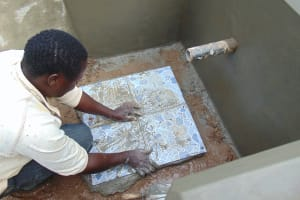 The Water Project: Bumavi Community, Joseph Njajula Spring -  Tile Setting