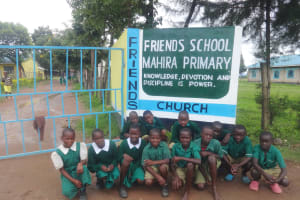 The Water Project: Friends School Mahira Primary -  Students Pose With School Sign
