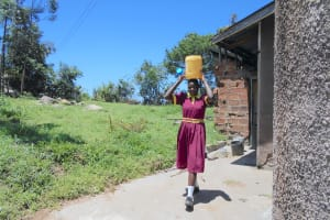 The Water Project: Givudemesi Primary School -  A Girl Collecting Water From Home