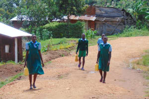 The Water Project: St. Kizito Kimarani Primary School -  Pupils Carrying Water From Home To School