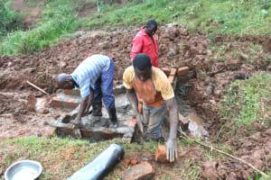 The Water Project: Shisere Community, Richard Okanga Spring -  Artisans Working On Spring Walls