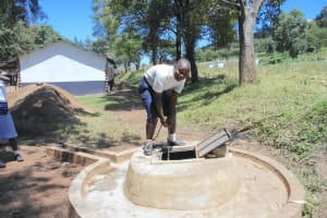 The Water Project: Friends School Shivanga Secondary -  Student Fetching Water From The Well