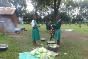 The Water Project: Friends School Mahira Primary -  Students Help Prepare Lunch