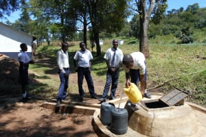 The Water Project: Friends School Shivanga Secondary -  Collecting Water At The Well